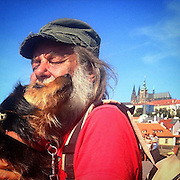 "Dusan with his beloved dog ""Tiger"" at Charles Bridge. Dusan lives without a permanent home and work. He said it is a typical vicious circle ""without a home no work and without work no home."" #prag #praha #prague #czechrepublic #czech #charlesbridge #latergram #portrait #goldencity #tschechien #dog #withouthome #portraitofsomebodyinevermetbefore"
