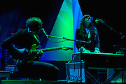 """Alex Scally (L) and Victoria Legrand of Beach House perform on September 3, 2010 in support of """"Teen Dream"""" at Red Rocks Amphitheater in Morrison, Colorado."""