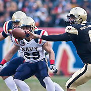 Army QB (#8) Trent Steelman shovels the ball late in the 2nd quarter. Navy set the tone early in the game as Navy defeats Army 31-17 in front of 69,223 at  Lincoln Financial Field in Philadelphia Pennsylvania