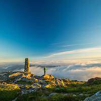 The cairn on Blåmanen with skies over Bergen