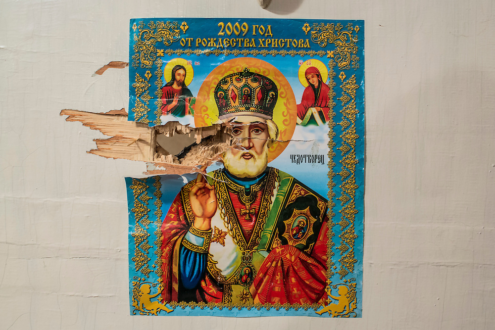 DONETSK, UKRAINE - JANUARY 23, 2015: A religious icon pasted to a door inside School 337 reveals shrapnel damage from a rocket attack two days earlier in Donetsk, Ukraine. Schools in Donetsk have been closed this week due to increased fighting, and will remain closed indefinitely. After the rebels finally took control of the heavily contested airport in Donetsk from the Ukrainian Army, they have promised an offensive to extend their territory further. CREDIT: Brendan Hoffman for The New York Times