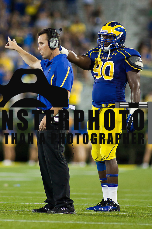 Head Coach K.C. Keeler (left) and Delaware Defensive tackle Quincy Barr #90 (right) signal to the defensive unit from the sideline during a Week 2 NCAA football game against Westchester in the  fourth quarter...#8 Delaware defeated Westchester 28-17  in their home opener at Delaware Stadium Saturday Sept. 10, 2011 in Newark DE...Delaware will return home Sept. 17, 2011 for a showdown with interstate Rival Delaware State at 6:pm at Delaware Stadium. (Monsterphoto/Saquan Stimpson)