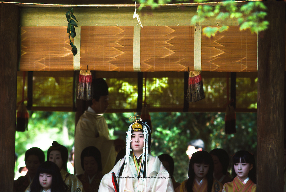 "Attendents with Miss Kazusa Nihimura (20 years old) the queen ""Saiodai""  at Misogi - No-Shinji the ceremony of purification & baptism. This is a pre event of the Aoi Matsuri (festival) Kamikamo Shrine, Kyoto, Japan"