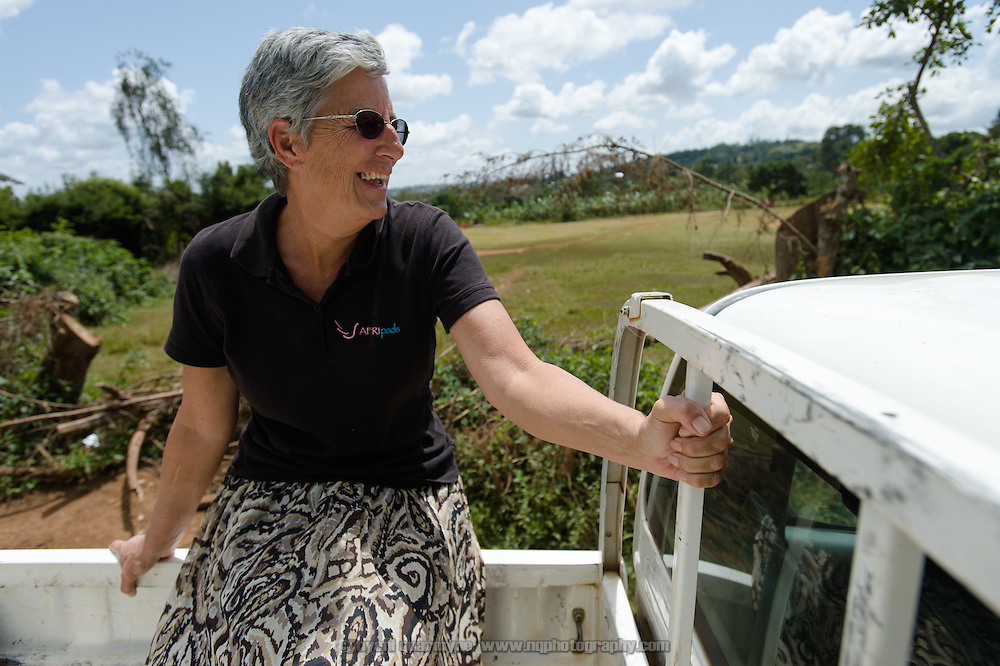 Dorothy Maynard, a volunteer at Afripads, riding in the back of a pick-up truck in the village of Kitengeesa in the Central Region of Uganda on 30 July 2014.