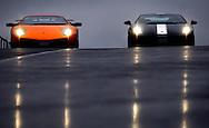 Scotsman Journalist Peter Ranscombe puts the Lamborghini Gallardo LP 550 Valentino Balboni (black) and the Lamborghini Murcielago LP 670 4SV (orange) through their paces at Knockhill Race Circuit in Fife, Scotland..Pic by Alex Hewitt
