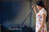 Stirring the dye at Womens Skills Development Project in Pokhara, Nepal. The WSDP was set up in 1975 as a non-profit, fair trade organization to help disadvantaged women in Nepal.