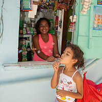 One of the proud shopkeepers of Santa Marta Community.