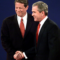 Debate handshake at UMASS Boston Oct3, 2000.  Al Gore and George Bush. Photo: Mark Garfinkel