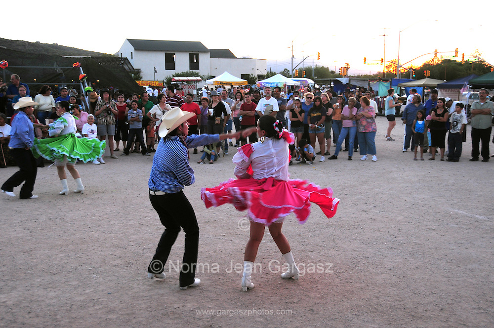 Folklorico Destino-Polkas performs at Dia De San Juan Fiesta at the Santa Cruz River Park, Tucson, Arizona, USA.