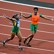 Terezinha Guilhermina FROM BRAZIL CELEBRATES WINNING THE 100M AT THE LONDON 2012 PARALYMPIC GAMES WITH HER GUIDE.