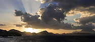 Sunrise behind Nevis, seen from St Kitts, British Virgin Islands in the Caribbean.<br /> Picture date: Sunday January 24, 2016.<br /> Photograph by Christopher Ison &copy;<br /> 07544044177<br /> chris@christopherison.com<br /> www.christopherison.com