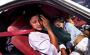 Maria Castro Castelo and her daughter, Maria, 3, of Veracruz, Mexico, and other illegal immigrants wait in a vehicle driven by a smuggler on the Tohono O'odham Nation after police stopped the vehicle on Route 86 at milepost 120.