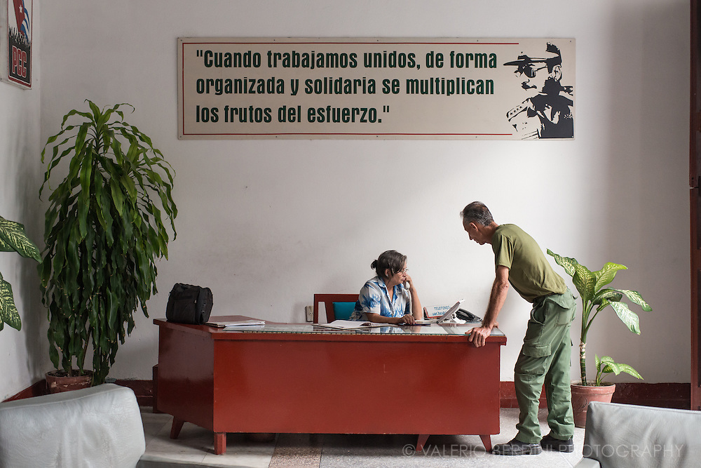 Two people working in an office of the PCC (Cuban Communist Party) the only party in the country. Cienfuegos. Cuba, 2015.