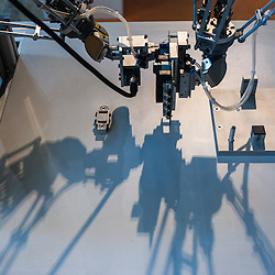 Lyon, France - 19 March 2014: Robot M-1iA by FANUC is on display at Innorobo 2014, the biggest fair in Europe for robotics.