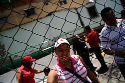 Volunteers work in the 23 de Enero barrio in Caracas. Every Saturday volunteers supportive of the government come out to clean up neighborhoods in different parts of Caracas.