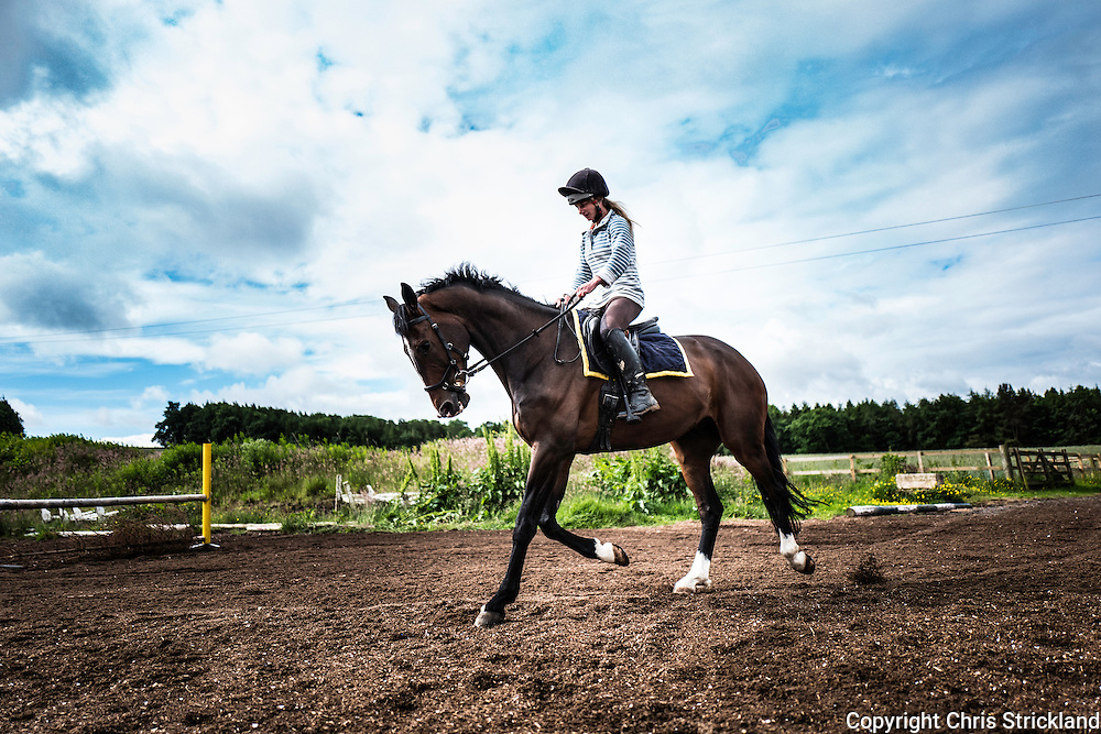 Ancrum, Jedburgh, Scottish Borders, UK. 30th June 2016. Four star eventer Emily Galbraith puts a horse through its paces while schooling at her yard in the Scottish Borders.