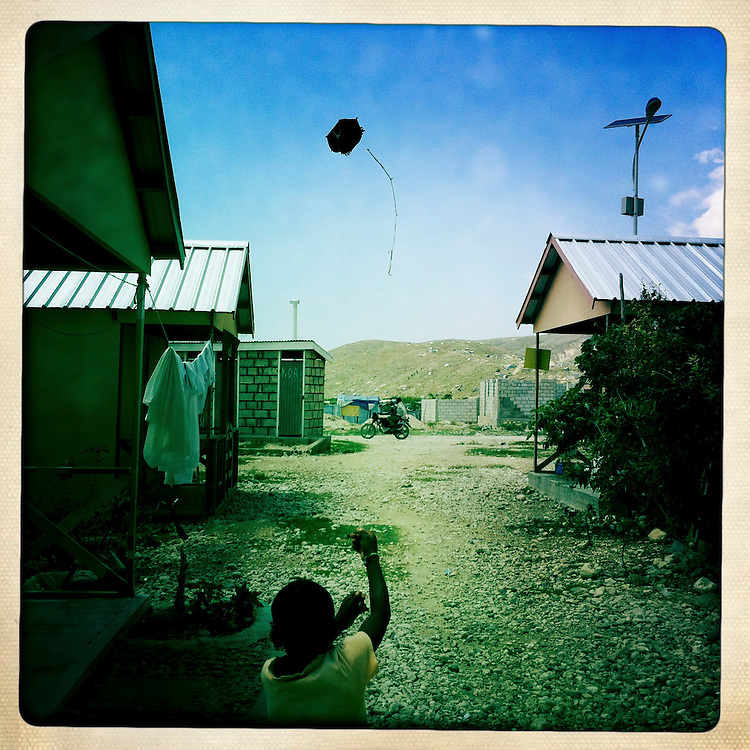 A boy flies a kite at the Corail camp on Thursday, April 5, 2012 in Port-au-Prince, Haiti.