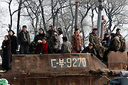 A group of North Koreans wait to board on a ship in the bank of the Yalu river in Sinuiju, North Korea, on Thursday, Feb. 8, 2007. The Six Party talks have started on the 8th of February in Beijing with the hope of terminating the nuclear program of North Korea
