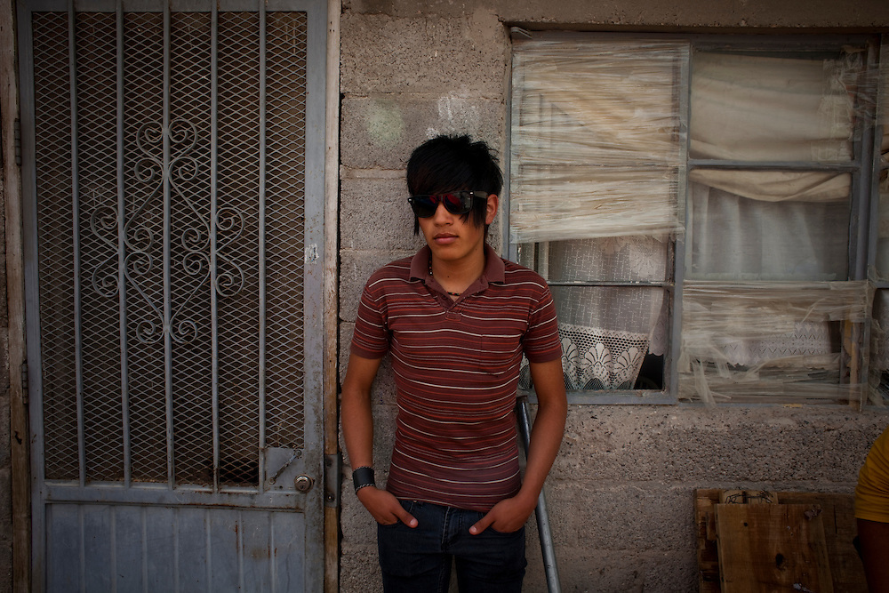 Luis Geraldo outside a friends house in the Diaz Ordaz colonia in Ciudad Juarez, Chihuahua Mexico on April 28, 2010.