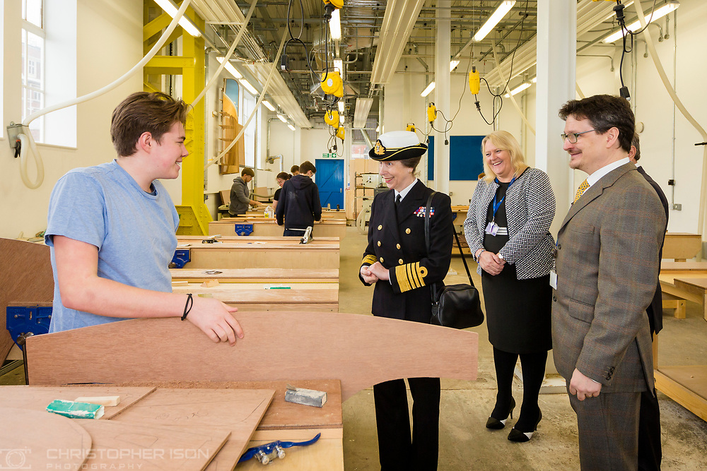 HRH The Princess Royal meets boatbuilding students from Highbury College's Solent Marine Academy during her commemorative visit to Boathouse 4 at Portsmouth Historic Dockyard today. The Boathouse opened last year following a &pound;5.7million restoration and features a boatbuilding academy, The Forgotten Craft exhibition, family activities and Midships restaurant.<br /> Picture date: Monday March 20, 2017.<br /> Photograph by Christopher Ison &copy;<br /> 07544044177<br /> chris@christopherison.com<br /> www.christopherison.com