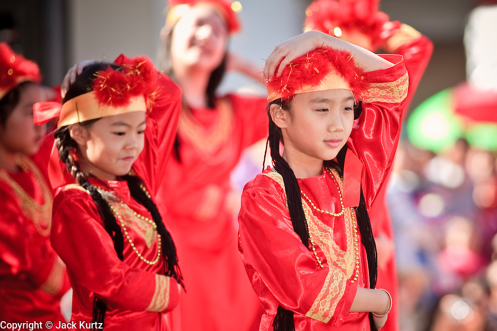 "14 FEBRUARY 2010 - PHOENIX, AZ: Girls perform a traditional Chinese dance during Chinese New Year celebrations in Phoenix, AZ. This marks the Chinese ""Year of the Tiger."" The Chinese New Year Celebration at the COFCO Chinese Cultural Center in Phoenix attracted thousands of people. The celebration featured traditional Chinese entertainment and food.  PHOTO BY JACK KURTZ"