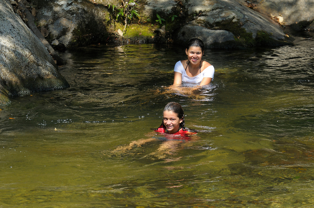 Kids swimming in Minca River, Minca, Sierra Nevada, Department Magdalena, Colombia