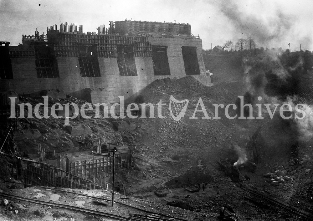 Ardnacrusha power plant in 1929. Located in Ardnacrushna, County Clare, it is Ireland's largest river hydroelectric scheme and is operated on a purpose built headrace connected to the River Shannon. The plant includes fish ladders so that returning fish, such as salmon, can climb the river safely past the power station.<br /> <br /> (Part of the Independent Ireland Newspapers/NLI Collection)