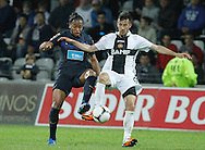 Portugal, FUNCHAL : Porto's player Alvaro(L) vies with Nacional's forward Aurelio (R) during their Portuguese football match at Madeira Stadium in Funchal on March 16, 2012. .PHOTO/GREGORIO CUNHA.Estadio da Madeira, Funchal, Liga Portuguesa de futebol, Nacional vs Porto. .Alvaro e Aurelio.Foto Gregório Cunha