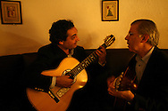 "Guitar players Carlos Garcia and Carlos Macedo fine tuning their instruments at the restaurant ""Senhor Vinho"" in Lapa neighborhood."