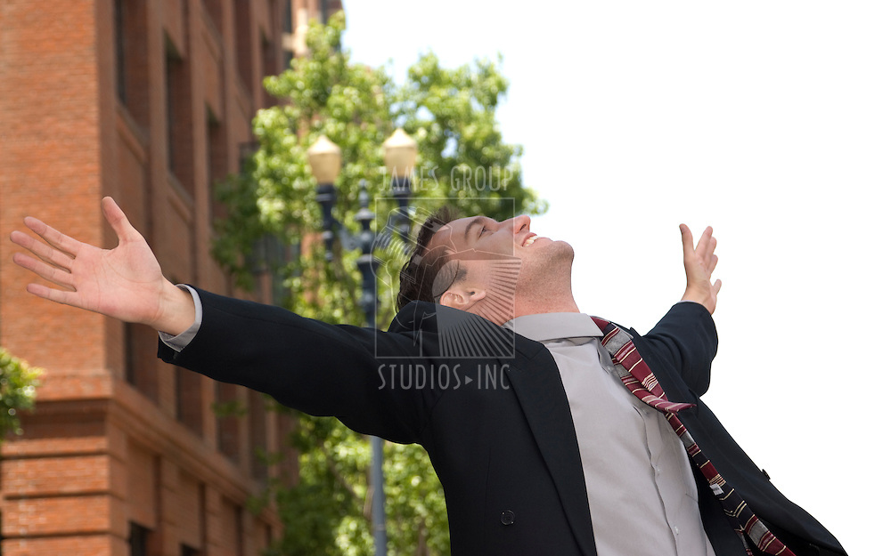 Businessman with arms stretched out in happiness with white space on the right for copy
