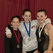 Claire Holliday (gold), Madison Little (silver) and Anna Pettus (bronze), all of the RAYS, swept the 11-12 girls 100 yard Individual Medley at the 2010 YMCA Upper Southeast Regional Championship, March 21, 2010