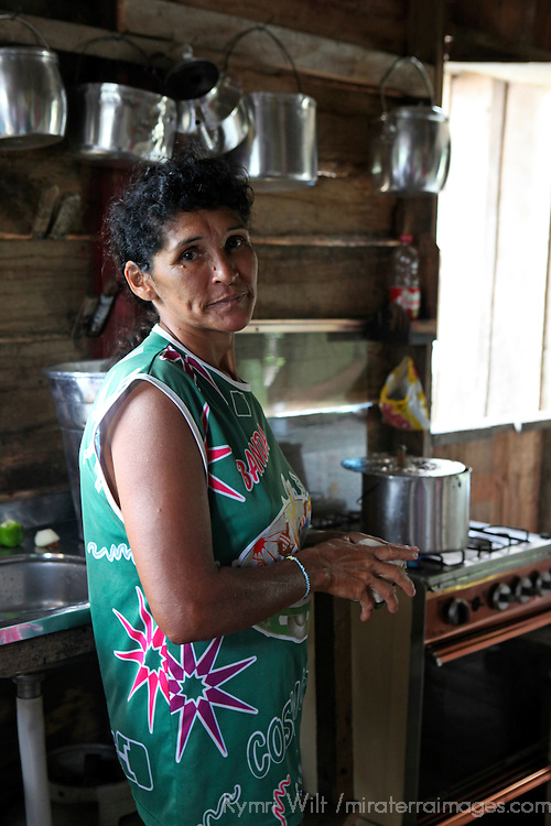 South America, Brazil, Amazon. Her pride is her kitchen  - an Amazon villager prepares lunch for her family.