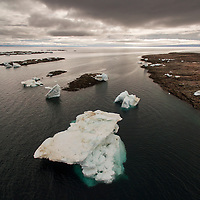 Canada, Nunavut Territory, Repulse Bay, Aerial view of grounded icebergs in Harbour Islands on Hudson Bay on summer morning