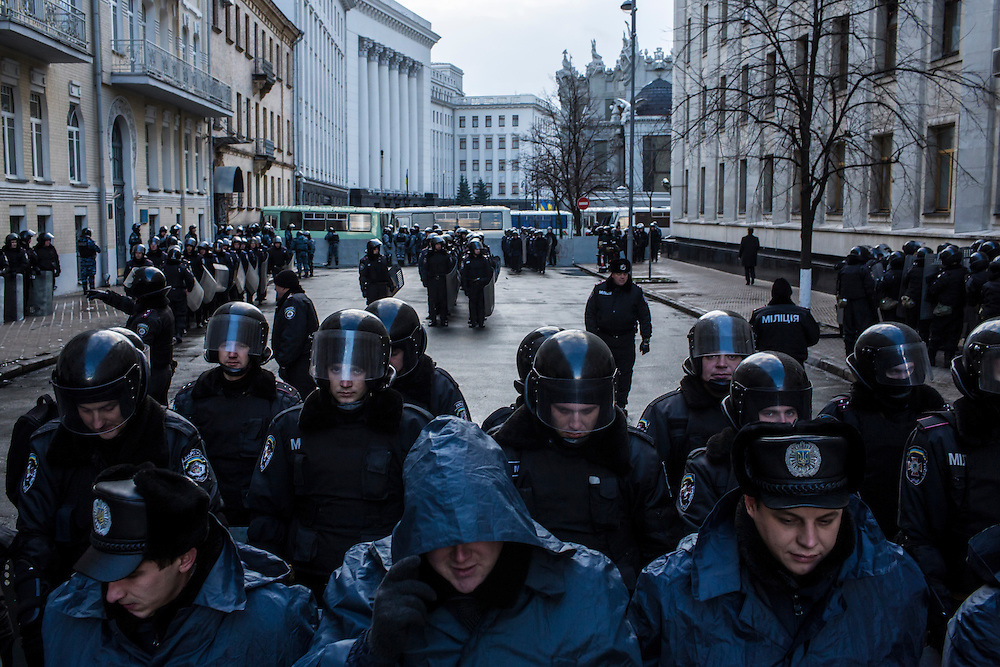 KIEV, UKRAINE - DECEMBER 6: Police officers stand guard outside the Presidential Administration building, protecting it from anti-government protesters, on December 6, 2013 in Kiev, Ukraine. Thousands of people have been protesting against the government since a decision by Ukrainian president Viktor Yanukovych to suspend a trade and partnership agreement with the European Union in favor of incentives from Russia. (Photo by Brendan Hoffman/Getty Images) *** Local Caption ***
