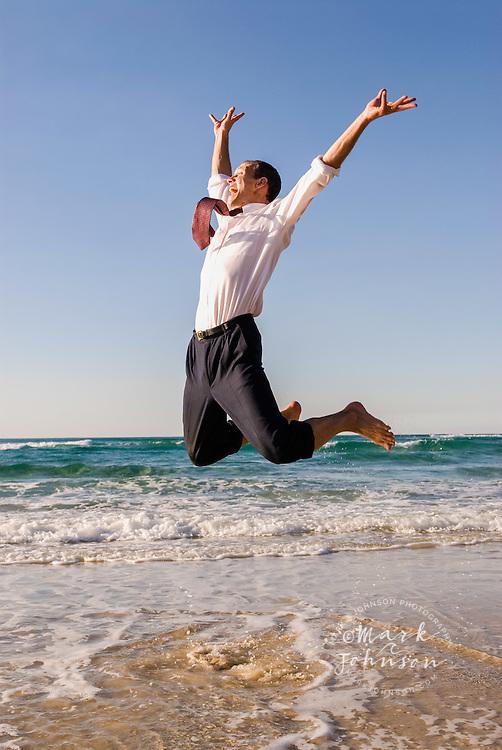 Businessman Jumping on Beach