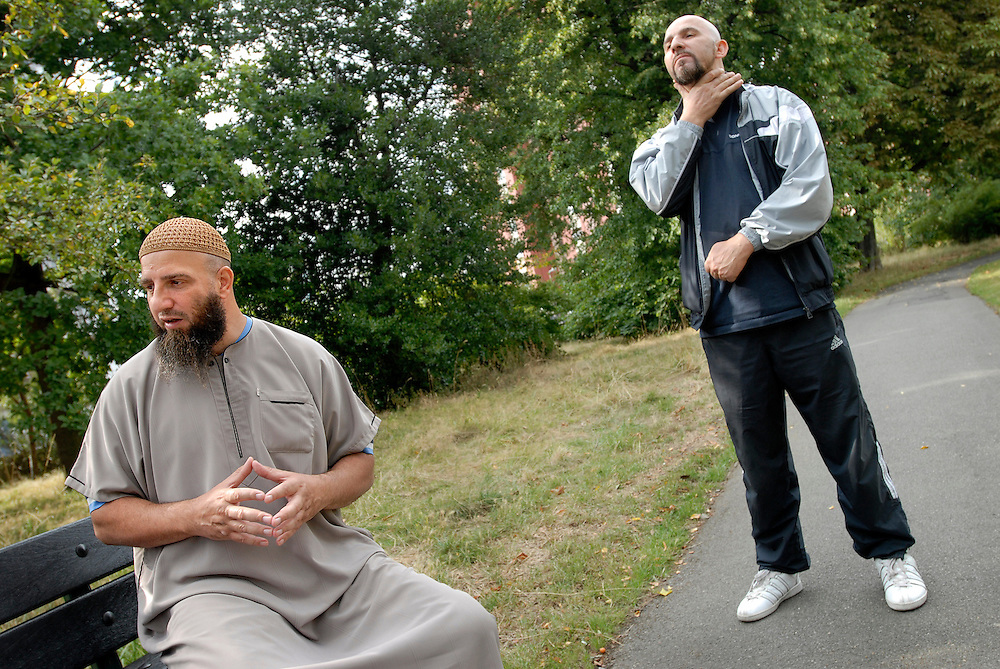 Abu Abdullah, who has taken over from jailed Abu Hamza as Emir of 'Supporters of Sharia' in the UK. Photographed with a bodyguard in Lewisham Park, South London, Britain...