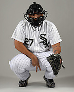 GLENDALE, ARIZONA - FEBRUARY 27:  Dioner Navarro #27 of the Chicago White Sox poses for a portrait while simulating flashing signs to a pitcher during photo day on February 27, 2015 at Camelback Ranch in Glendale Arizona.  (Photo by Ron Vesely)    Subject:  Dioner Navarro