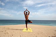 Yoga at the beach with your personal trainer. Josh Smith, personal trainer for health & wellbeing is showing us some yoga poses, exercises and postures while practicing yoga, and other exercise routines. Photographs are taken at the beach of Pedregal in Cabo San Lucas, Baja California Sur, Mexico