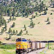 General Electric locomotives lead the way as yet another coal train from the northwestern Colorado coal fields on the Craig Branch descends the Rocky Mountains on the Moffat Route.