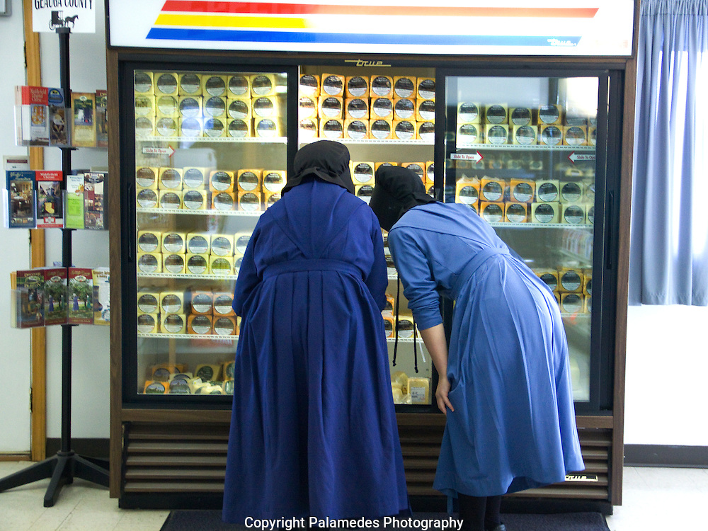 Two amish women shop for cheese at the Middlefield Original Cheese Co-Op in Middlefield, Ohio.