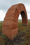 Andy Goldworthy's red sandstone Striding Arches land art sculpture on the summit of Benbrack near Cairnhead, Southern Uplands, Scotland