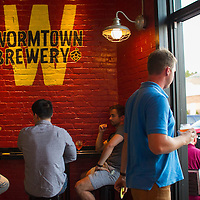 Customers head out to the patio of the tap room at Wormtown Brewery in Worcester, Massachusetts room on August 28, 2015.  Matthew Healey for The Boston Globe<br /> <br /> (MAGAZINE Story Editor Francis Storrs, Assigning editor Jim Wilson, Visuals editor Lloyd Young)