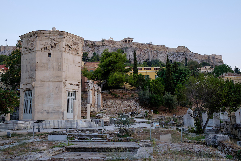"""Aerides - The Tower of the Winds or the Horologion of Andronikos Kyrrhestes is an octagonal Pentelic marble clocktower in the Roman Agora in Athens that functioned as a horologion or """"timepiece"""". Unofficially, the monument is also called Aerides (Greek: Αέρηδες), which means Winds. The structure features a combination of sundials, a water clock, and a wind vane.[1] It was supposedly built by Andronicus of Cyrrhus around 50 BC, but according to other sources, might have been constructed in the 2nd century BC before the rest of the forum. In summer of 2014, the Athens Ephorate of Antiquities began cleaning and conserving the structure; restoration work was completed in August 2016."""