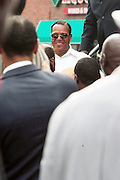 New York, NY-August 13-  Hon. Louis Farrakhan exits the stage at the Millions March in Harlem with keynote speaker Hon. Louis Farrakhan held at the corner of West 110th and Lenox Avenue in Harlem on August 13, 2011 in New York City. Photo Credit: Terrence Jennings