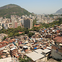 Million dollar view from a hundred dollar shack. The favelas enjoy some of the best and most sought after views in Rio. This doesn't mean the wealthy would trade houses though.