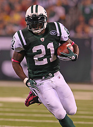 Oct 11, 2010; East Rutherford, NJ, USA; New York Jets running back LaDainian Tomlinson (21) runs with the ball during the first half of their game against the Minnesota Vikings at the New Meadowlands Stadium.