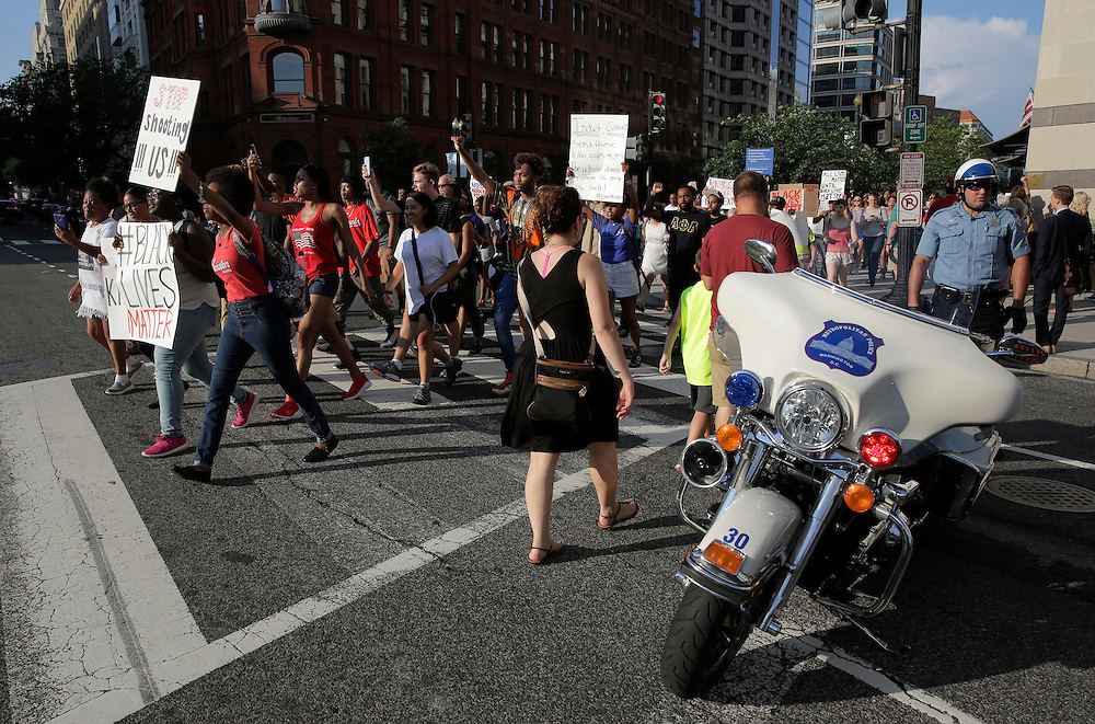 A Metropolitan police officer blocks traffic for Black Lives Matter protesters during a rally in Washington, U.S., July 8, 2016.  REUTERS/Joshua Roberts