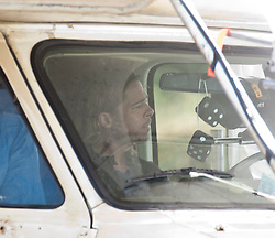 "Brad Pitt filming in a camper van, on the set of the movie ""World War Z"" being shot today in Grangemouth, Scotland. The film, which is set in Philadelphia, is being shot in various parts of the Glasgow, transforming it to shoot the post apocalyptic zombie film.."