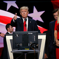 Republican presidential nominee Donald Trump gives a thumbs up as his campaign manager Paul Manafort (C) and daughter Ivanka (R) look on during Trump's walk through at the Republican National Convention in Cleveland July 21, 2016.  REUTERS/Rick Wilking