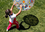 Fernanda Garcia-Villanueva tosses a ball at a group exercise session in the 10-week Shapedown Program at The Children's Hospital in Aurora, Colorado May 29, 2010.  The program is part of the child and teen weight management program at the hospital. REUTERS/Rick Wilking (UNITED STATES)